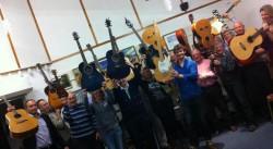 holding guitars up - Antony Reyneart